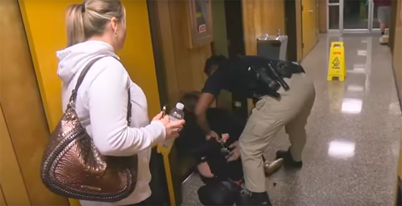Teacher questioning administrative pay raises removed from board meeting in handcuffs