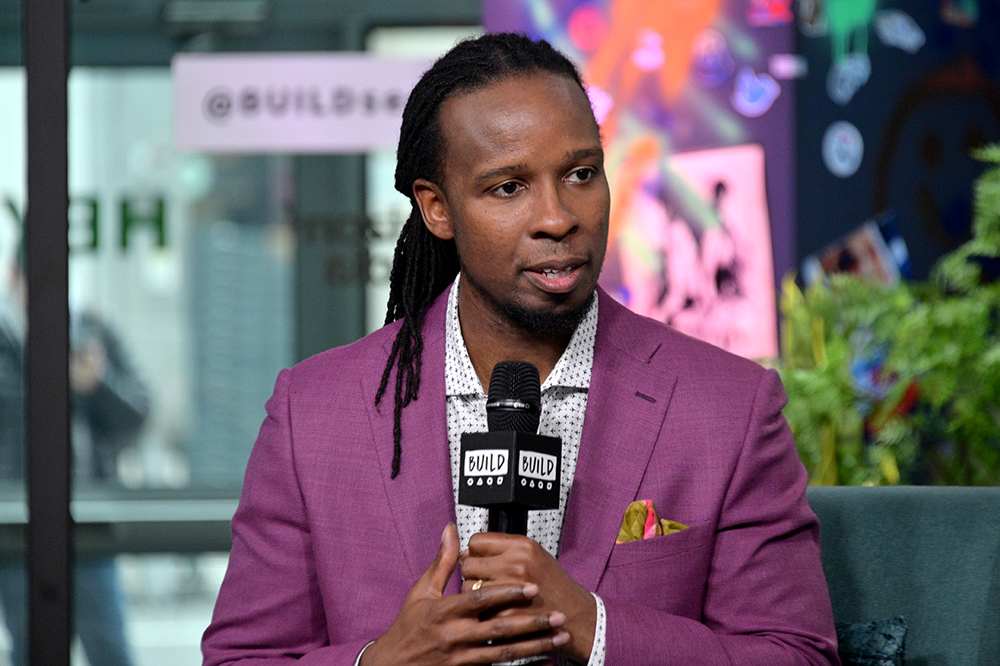 Ibram X. Kendi is pictured speaking at an event.